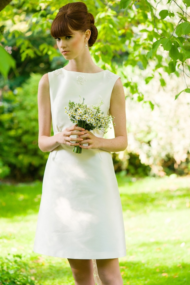 5c8fde3e819 This classic sleeveless short wedding dress continues the season s love  with the sixties. Petunia is designed in silk Mikado with a distinctive  heart shaped ...
